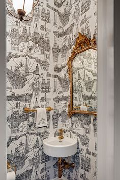 A small black and white powder room is filled with a gold ornate mirror over a c. A small black and white powder room is filled with a gold ornate m Black Powder Room, Tiny Powder Rooms, Gold Powder, Powder Room Decor, Powder Room Design, Guest Toilet, Small Toilet, Guest Bath, Gold Ornate Mirror