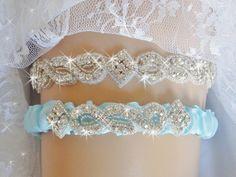 A personal favorite from my Etsy shop https://www.etsy.com/listing/249491944/baby-blue-rhinestone-wedding-garter-set