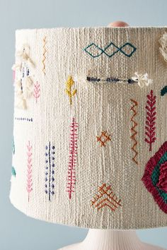 Embellished Noreen Lamp Shade by Anthropologie in Assorted, Lighting Featuring tufts of texture and colorful embroidery, this eclectic lamp shade brings a touch of fun to your space. Eclectic Lamp Shades, Eclectic Lamps, Embroidery Stitches, Hand Embroidery, Embroidery Designs, Tapetes Diy, Deco Boheme, Textile Art, Needlework