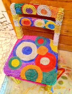 child's chair covered in old mardi gras beads..how cute!