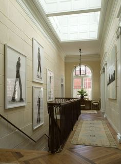 The layout of the hallway is almost exactly like mine. The stairs, and landings are in the same place. I like the idea of big pictures on the wall trailing down the stairs.