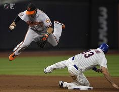 Mets' Rottino is out at second after tripping up Orioles' Roberts during the fifth inning of their MLB Interleague baseball game in New York. ADAM HUNGER/REUTERS