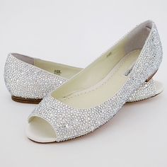 Benjamin Adams Halle Crystal Flats. Finally! The fabulous crystal shoe trend comes to a pair of adorable flats! Swarovski covered ivory silk flats with a peep toe. Glamour & comfort. By Benjamin Adams.