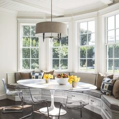The Robert Abbey hanging light adds stylish flair to this breakfast nook.