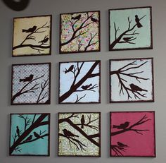 """I painted this for our dining room.  12"""" x 12"""" Scrapbook paper glued on 12"""" x 12"""" canvas with 1 part school glue to 2 parts water.  Let dry over night (the bubbles will go away as the glue dries). Then paint the sides and edges of the canvas and birds/branches!"""