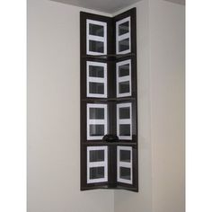 """Four Tier Hanging Corner Shelf Picture Frame by 4D Concepts. $84.00. Color: Espresso. Size: 53.1""""H x 11.8""""W x 11.8""""D. 16 Picture frames for 3.5""""x5"""" prints. 4 Display ledges. Matting can be removed for larger prints. 94810 Features: -Hanging corner shelf.-Four shelves beautifully placed to utilize any corner space in the home.-Metal fitting at the back allows for easy sliding onto anchor screws attached to the wall.-Hardware comes with drywall anchors.-Clean with a dry non ab..."""