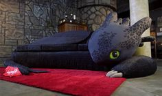 "For the first episode of the third season of ""Super-Fan Builds"" the folks at AWE went all out and created a couch shaped like Toothless from ""Dragons: Race to the Edge"". They built it for a hardcore fan of How to Train Your Dragon."