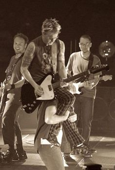 """Stage antics.  Love how Jeff is smiling and Stone is giving the """"yeah, it's all fun until someone gets hurt"""" look!"""