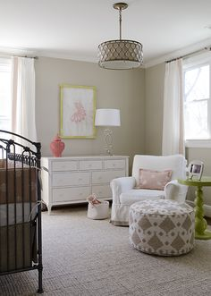 nurseries - tan walls white drapes coral pink Greek key trim antique trim pink gray crib bedding jute rug pink gray pouf white glider coral pink carthage lantern glossy green lacquer green spindle table