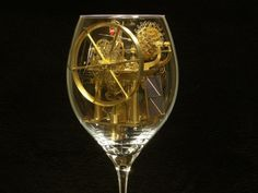 Man makes fascinating machines inside wine glasses.