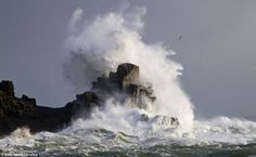 Huge waves batter the coast at Lamorna Cove near Penzance in Cornwall as storm-force winds hit the region