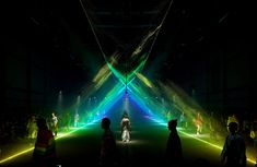 Models walked through an archway of rainbow-hued lasers at Burberry's London Fashion Week show, which featured light installations by United Visual Artists.