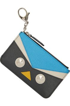 FENDI Crayons textured-leather bag charm $250 EDITORS' NOTES & DETAILS Fendi's 'Crayons' bag charm is crafted in Italy from gray, azure, off-white and yellow textured-leather. Finished with conical studs, it is a characterful way to store your cards and coins. Attach your keys to the concealed keychain inside.  Gray, azure, off-white and yellow textured-leather (Calf) Zip fastening at top