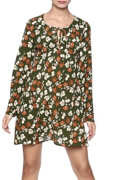 Olive green floral print long sleeves dress with string on the neck.   Olive Floral Dress by Pink Penguin. Clothing - Dresses - Floral Clothing - Dresses - Long Sleeve West Village, Manhattan, New York City