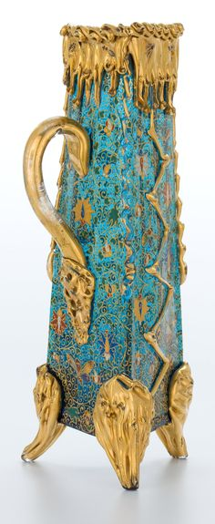 "cair–paravel: "" Glass with gilt and enameled decoration on three applied gilt feet and with applied gilt handle, Moser Glass Company, c. 1900. """