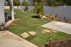 Complete landscape makeover, frontyard & backyard in Camarillo, California. Curve-linear patterns and low water use plantings bring this project into the 21st century. By Scarlett's Landscape, Inc. http://scarlettslandscaping.com/