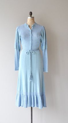 Vintage 1970s sky blue cotton-acrylic knit dress with pointelle knit sleeves, button bodice, elastic fitted waist, tie belt and flared skirt hem. ---