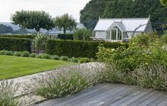 Country Garden Design Surrey with greenhouse
