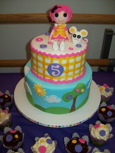 - Lalaloopsy Cake and cupcakes. All decorations made in fondant.