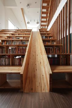 A Library Slide We love this wooden slide that is slotted into a combined staircase and bookshelf of a house in Chungcheongbuk-do, South Korea, Designed by Moon Hoon. Submitted by Bookshelf Porn...