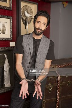 Adrien Brody promoting Houdini in handcuffs