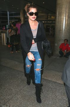 Lamar, where are you: Khloe, pictured at LAX on October 12, has tried to reach her ex-husb...