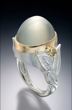 Green Mango moonstone ring, grossular garnet accents set in Platinaire(R),silver and platinum blend, and 18k gold by Conni Mainne