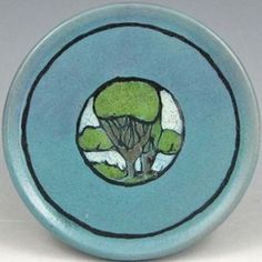 Saturday Evening Girls, Paul Revere plate in blue with scene of trees near a river, 1922. Marked SEG 9-22 with artist's mark.  Arts and Crafts ceramics, Craftsman bungalow