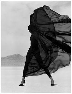 Herb Ritts: 'Versace, Veiled Dress'. El Mirage, California, 1990. Model: Naomi Campbell. Versace, Fall, 1990.