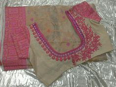 Tissue kota saree blouse with net in neck line with kundans and side aplic work 7702919644