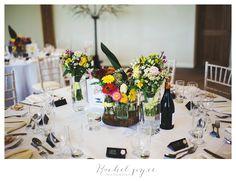 This couple had chosen a 'no colour scheme' theme and decorated their venue in seasonal flowers from their local flower market.   Ribble Valley Weddings   Wedding Photographer in Lancashire   Wedding at the Outbarn in Clough Bottom   www.racheljoycephotography.co.uk