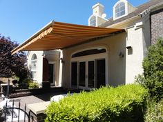 Our Somfy Motorized Retractable Awnings Let You Safely Enjoy Your Outdoor Space With Style And Fashion