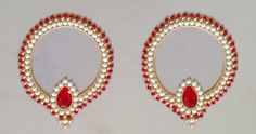 Large decorative pieces for placing diyas. Design has a large red stone surrounded by a pearl lining