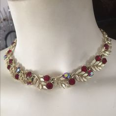 "Vintage LISNER Red AB Rhinestone Chocker Necklace This exquisite Vintage LISNER adjustable Chocker Necklace features genuine Red Aurora Borealis Red Rhinestones and Gold-tone leave sprigs. Measures 16-1/2""end-to-end x 1/2"" at mid-section. In excellent preowned vintage condition. Vintage Jewelry Necklaces"