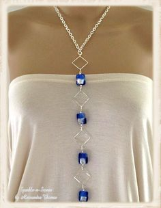 The Heidi Necklace - This elegant necklace will add some color to your wardrobe. A slimming silhouette of stunning ice blue and silver *lampwork squares beg to be worn. This beauty will work with your everyday wardrobe or your weekend attire.