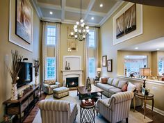 Toll Brothers 2-Story Family Room.  Nice placement of artwork on the upper parts of side walls.