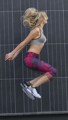 """Stand out in these red camo capri""""s excluisve to BANDIER."""