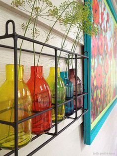how to frame huge prints inexpensively, diy, how to, painting, wall decor, woodworking projects, I have colorful glass bottles hanging on the wall next to the prints