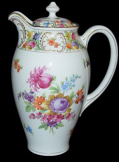 Schumann Dresden Flowers Chocolate Pot - White background with a pattern of blues, green, pinks, oranges and yellows. Gold Trim. - Circa: 1920s - Early 20th Century Porcelain Floral Chocolate Pot