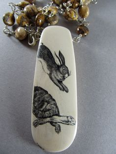 tortoise and the hare scrimshaw on fossil mammoth ivory. $350.00, via Etsy.