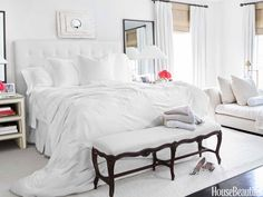 """""""I like the serenity of pure white linens and very soft, muted colors,"""" Brooke Davenport says of the master bedroom."""