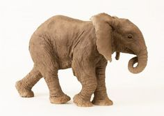 Ceramic Wild Animals and Wild Life sculpture by sculptor Lesley Prickett titled: 'Young African Elephant (Small Elephant Calf statuette)'