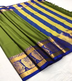 Fabric : Cotton Silk Color : Green, Blue Length – 5.50 Meter & 0.8 Meter Blouse Package Content : 1 Saree With 1 Blouse Piece Work : Weaving Product color may slightly vary due to photographic lighting sources or your monitor settings. Wash Care : DRY CLEAN ONLY International shipping is available Contact us / whats app us : +91 9725728989