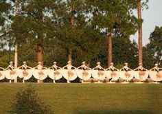 Apache Belles doing the traditional rim