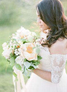 Organic British grown wedding bouquet full of blush peach peonies via Wedding Sparrow blog www.weddingsparrow.com