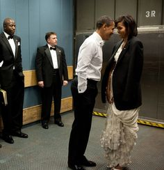 The President and Mrs. Obama being sweet together <3