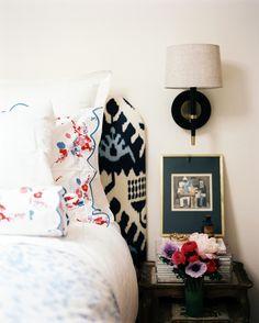 ikat upholstered headboard + d. porthault linens   lonny
