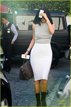 Kylie Jenner covers up her pretty face from the cameras after getting her nails done in Los Angeles on Friday afternoon (March 6).