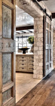 stone wall. kitchen feature. barn doors. darker finish