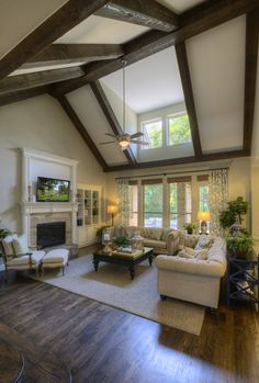 A pitched ceiling with a strategically placed window feels extra grand with the extra light. Seen in Estancia, a Dallas community.